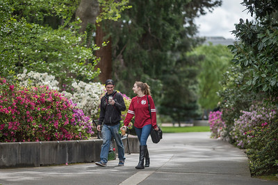 """Student walk past """"Old Hutch"""" Plaza through campus on Thursday, April 13, 2017 in Chico, Calif. (Jason Halley/University Photographer)"""