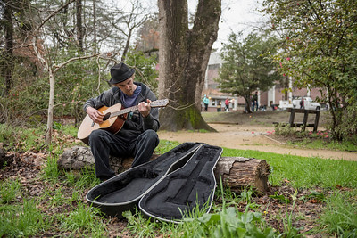 Environmental science major Anthony Dewey, 23, plays his guitar in the Mary Lemcke Camellia Garden, located on the north side of Big Chico Creek, near Holt Hall, on Wednesday, February 8, 2017 in Chico, Calif.  (Jason Halley/University Photographer)
