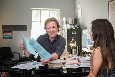 History professor Jason Nice works with a student in his office on Wednesday, May 10, 2017 in Chico, Calif.  (Jason Halley/University Photographer)