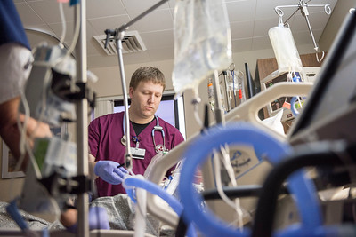 Nursing student Paul Herrick works with a patient during his day shift in the Intensive Care Unit at Feather River Hospital as part of a Rural Nursing Program on Thursday, January 19, 2017 in Paradise, Calif.  (Jason Halley/University Photographer)