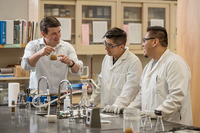 Faculty Jackson Webster (left) works with Uriel Dominguez Guzman (left) and Jonathan Campos (right) on Effects of Drinking water treatment residuals on nitrogen mineralization in agricultural soils as part of a Summer Undergraduate Research Program (UGR) involved in the Chico STEM Connections Collaborative (CSC2) program on Thursday, July 13, 2017 in Chico, Calif.  (Jason Halley/University Photographer)