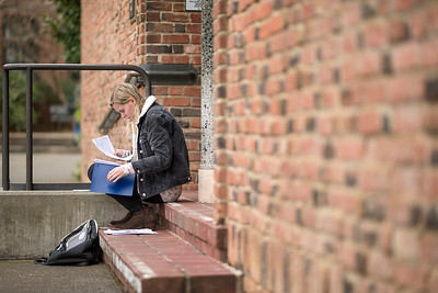Child Development sophomore Kelly Hosley, 20, reviews classwork during a break on campus on Monday, February 13, 2017 in Chico, Calif.  (Jason Halley/University Photographer)