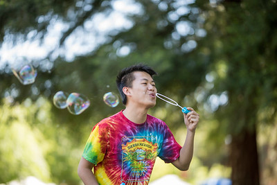 Vu Nguyen blows bubbles as students learn about different nationalities during the International Festival on the Kendall Hall lawn on Saturday, April 29, 2017 in Chico, Calif. (Jason Halley/University Photographer)