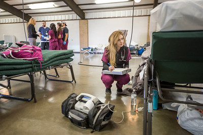 School of Nursing student Shannon Watson, 22, assisted with patient care and health needs for evacuees of the Oroville Dam Spillway Incident at the Evacuation Center at the Silver Dollar Fairgrounds on Tuesday, February 14, 2017 in Chico, Calif. The controlled spillway for the Oroville Dam, south of Chico, experienced damage during the week of Feb. 6-12, resulting in the use of the emergency auxiliary spillway and evacuation of over 180,000 people. (Jason Halley/University Photographer)