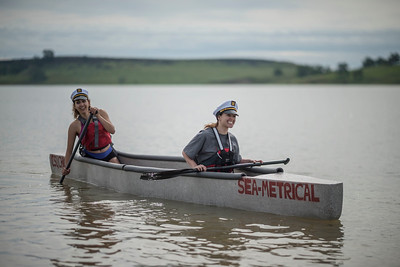 Engineering students Brianna Murphy (left) and Angie Hodskins (right) race concrete canoes at Black Butte Lake during the American Society of Civil Engineers 2017 Mid Pacific Regional Conference on Saturday, April 22, 2017 in Orland, Calif. (Jason Halley/University Photographer)