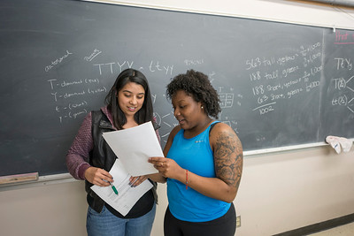 Tutor Nely Lopez, 21 (left) helps Tia Peete, 19, (right) as students study in the Chico STEM Connections Collaborative - CSC2 Natural Sciences Study Center in Holt 125 on Thursday, April 27, 2017 in Chico, Calif. (Jason Halley/University Photographer)