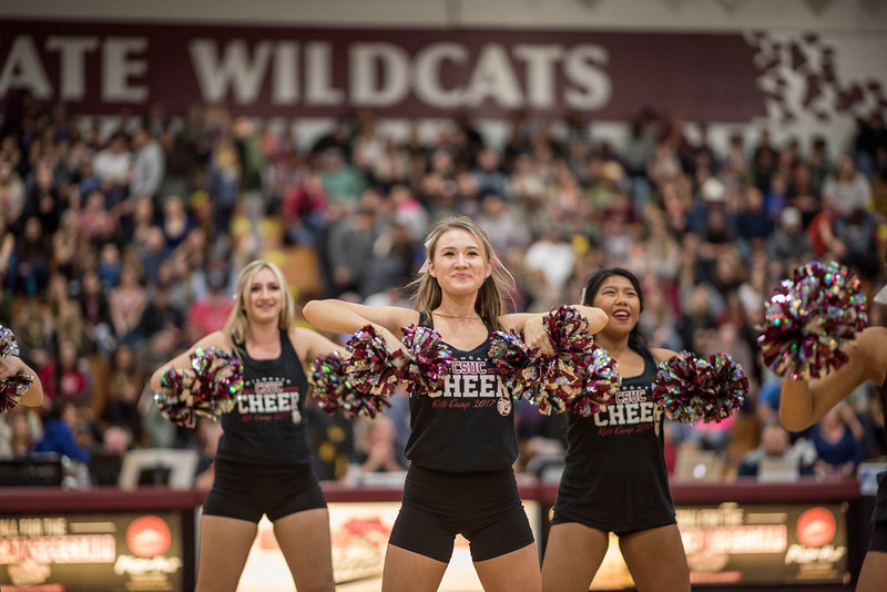 The Chico State Cheer team dances during the Chico State Wildcats against Cal State Stanislaus men's basketball game at Acker Gym on Saturday, February 18, 2017 in Chico, Calif. <br /> (Jason Halley/University Photographer)