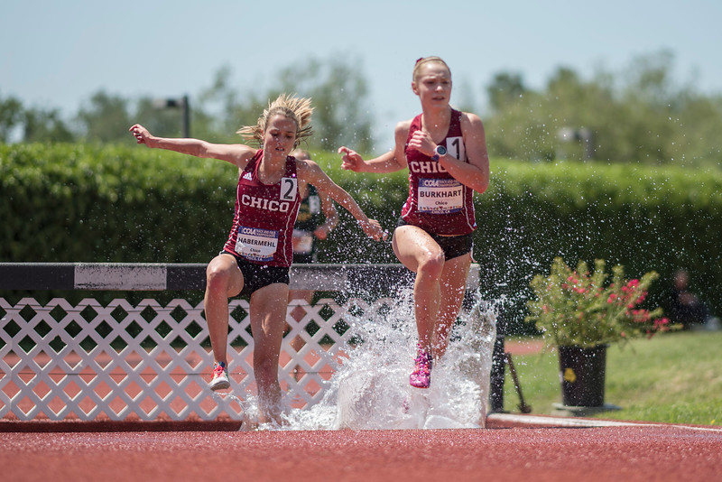 McCall Habermehl (left) and Alex Burkhart (right) lead the women's 3000m steeplechase as athletes compete during the California Collegiate Athletic Association Track & Field Championships on Saturday, May 6, 2017 in Chico, Calif.<br /> (Jason Halley/University Photographer)