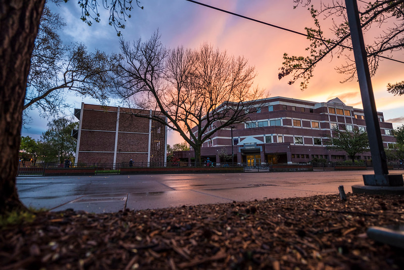 A dramatic sunset colors the sky after a break in the rain and clouds over campus on Wednesday, March 22, 2017 in Chico, Calif.<br /> (Jason Halley/University Photographer)