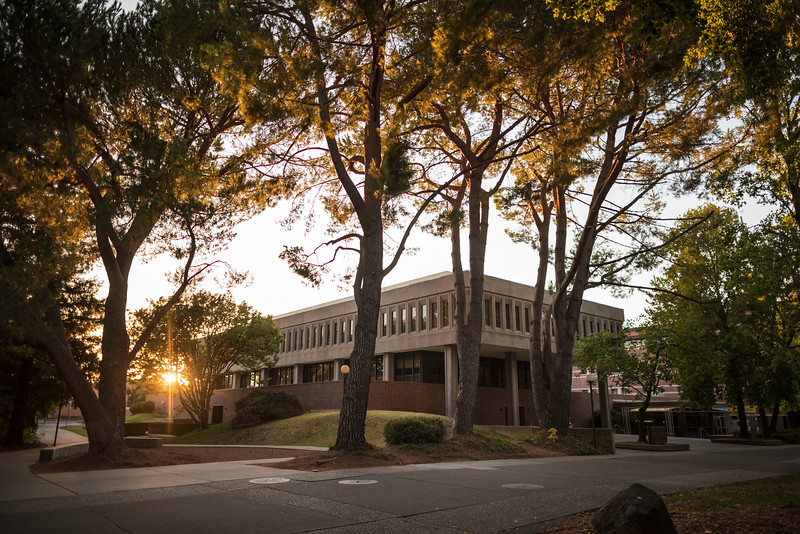 The sun sets behind Plumas Hall on Saturday, October 7, 2017 in Chico, Calif.<br /> (Jason Halley/University Photographer)