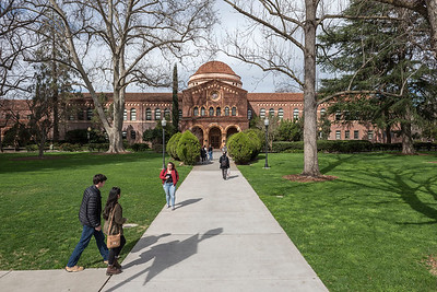Students walk toward Kendall Hall on Wednesday, February 22, 2017 in Chico, Calif.  (Jason Halley/University Photographer)