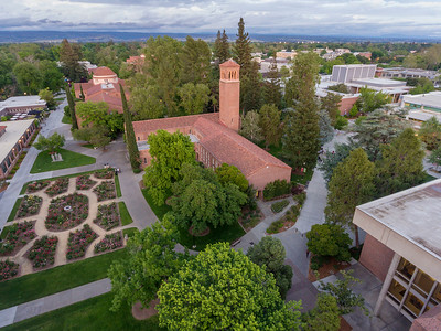 A sunset over campus looking from a aerial drone over George Petersen Rose Garden, Trinity Hall, and Kendall Hall on Wednesday, April 26, 2017 in Chico, Calif. (Jason Halley/University Photographer)