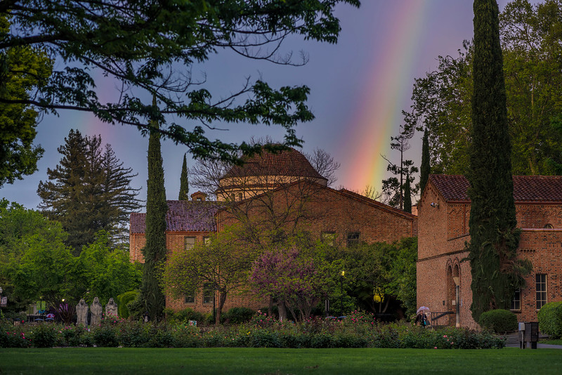 A rainbow is seen over Kendall Hall on Wednesday, April 12, 2017 in Chico, Calif.<br /> (Jason Halley/University Photographer)
