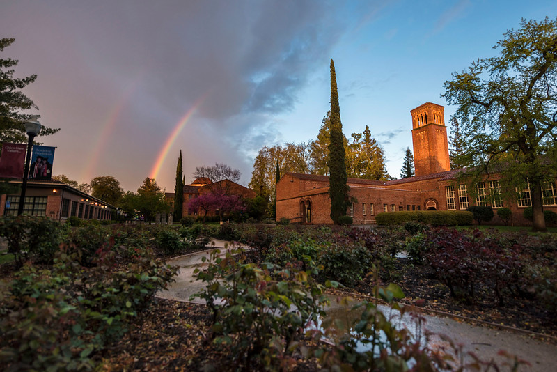 A break in the rain and clouds brought a rainbow over Trinity Hall, George Petersen Rose Garden, Kendall Hall and Colusa Hall on Wednesday, March 22, 2017 in Chico, Calif.<br /> (Jason Halley/University Photographer)