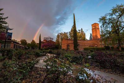 A break in the rain and clouds brought a rainbow over Trinity Hall, George Petersen Rose Garden, Kendall Hall and Colusa Hall on Wednesday, March 22, 2017 in Chico, Calif. (Jason Halley/University Photographer)