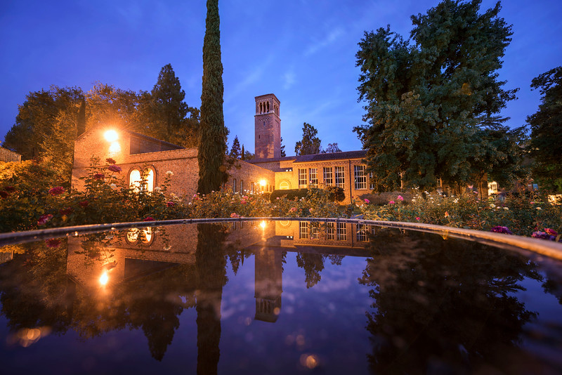 Trinity Hall is reflected in the fountain in the George Petersen Rose Garden on Thursday, September 21, 2017 in Chico, Calif.<br /> (Jason Halley/University Photographer)