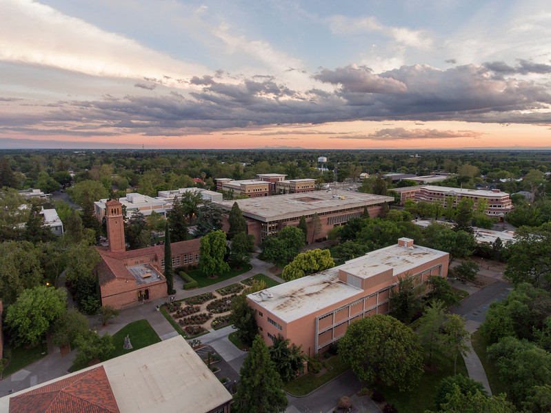 A sunset over campus looking from a aerial drone over Glenn Hall, George Petersen Rose Garden, Trinity Hall, Meriam Library, O'Connell Hall on Wednesday, April 26, 2017 in Chico, Calif.<br /> (Jason Halley/University Photographer)