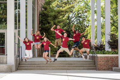Summer Orientation (SUMO) student leaders Jeanine Koenig, Patricia Lecaros, Kim Helms, Alex Rangel, CJ Knoble, Jasmine Taylor, and Arby Lapira (left to right) jump as they take group photos for the Orientation & New Student Programs (ONSP) on Tuesday, May 30, 2017 in Chico, Calif.  (Jason Halley/University Photographer)