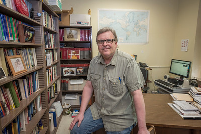 History faculty Jeff Livingston in his office on Tuesday, May 2, 2017 in Chico, Calif. (Jason Halley/University Photographer)