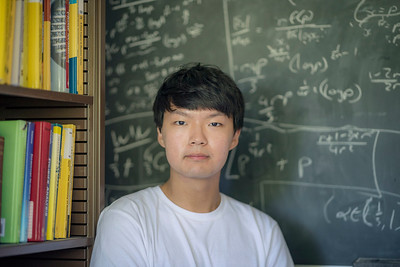 Outstanding Mathematics and Statistics graduating senior Jongwoo Choi is committed to earning honors in both mathematics options by submitting two honor's theses simultaneously—which would make him the first math student to do so at Chico State, has his portrait taken, on Friday, April 21, 2017 in Chico, Calif. (Jason Halley/University Photographer)