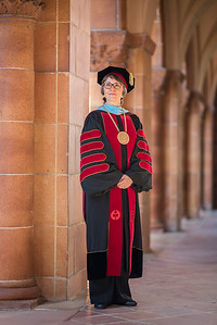 President Gayle Hutchinson wears her commencement robe and medallion regalia during a photo shoot prior to her Inauguration ceremony at Laxson Auditorium arches on Tuesday, February 28, 2017 in Chico, Calif. (Jason Halley/University Photographer)