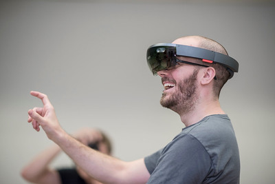 """Computer Animation and Game Development (CAGD) student Lance Mitchell wears a Microsoft HoloLens as students test out state-of-the-art Virtual Reality and Augmented Reality equipment, like Oculus Rift, HTC Vive, Google Daydream and Microsoft HoloLens in MADT 399, a cross-listed """"Virtual & Augmented Reality for Gaming & Media"""" course among J&PR, Media Arts, Design & Technology, and Computer Animation & Game Developments on Thursday, September 7, 2017 in Chico, Calif. (Jason Halley/University Photographer)"""