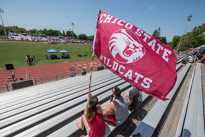 Fans wave a flag to support athletes that compete during the California Collegiate Athletic Association Track & Field Championships on Saturday, May 6, 2017 in Chico, Calif. (Jason Halley/University Photographer)