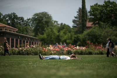 Autumn Stephens relaxes on Glenn Lawn on Thursday, May 11, 2017 in Chico, Calif.  (Jason Halley/University Photographer)