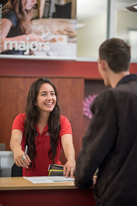 Academic Advising staff Dana Centeno (left) assists Nolan Squyres (right) in the Academic Advising office on Wednesday, April 12, 2017 in Chico, Calif. (Jason Halley/University Photographer)