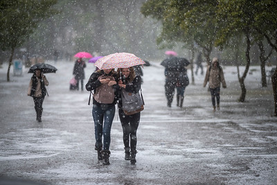 Students walk through the south gauntlet as a thunderstorm brought in a lot of hail, rain and small flooding on campus on Thursday, April 13, 2017 in Chico, Calif. (Jason Halley/University Photographer)