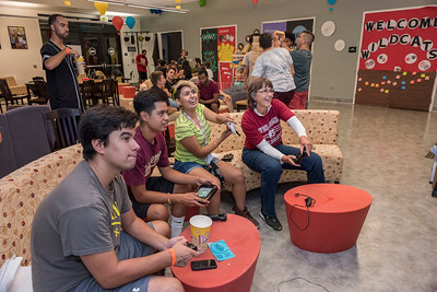 Terence Zegarra, Willie Patino, Mitsi Patino, and President Gayle Hutchinson (left to right) play NIntendo with students during Rock the Block event before campus leadership walk through the south campus area to view the party and nightlife on Friday, August 18, 2017 in Chico, Calif. (Jason Halley/University Photographer)