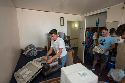 Nico Arredondo unpacks with help from Drew Arredondo (left to right) as volunteers help new students move in to their dorm rooms on Thursday, August 17, 2017 in Chico, Calif. (Jason Halley/University Photographer)