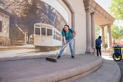 Criminal Justice major Yesenia Vazquez, 18, cleans up the City Plaza as students spent César Chávez Day giving back through the 'Cats in the Community event, which sends volunteers to local parks and nonprofit organizations to help out on Thursday, March 31, 2016 in Chico, Calif.  (Jason Halley/University Photographer)