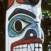 Totem figure at the base of the dorsal fin of an Orca whale carving at the entrance to the Burke Museum. This figure is a replica carved by Bill Holm of a grave monument in Howkan, AK.