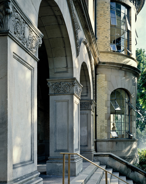 Denny Hall entrance with replica of the bust of the Charioteer from Delphi seen in the window of the Classics Department lounge.  This photograph was taken on a warm morning in June, 1988.  Note the spray from a lawn sprinkler on far right of photo near the bottom.