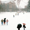 Students walking across the Quad in a snowstorm in January, 1989