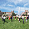 Dance class on Rainier Vista lawn in front of Drumheller Fountain