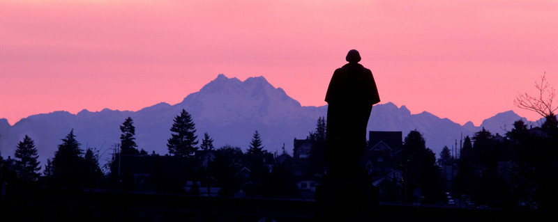 George Washington overlooking the Olympic Mountains.  This photo and the orange version of the same scene were taken about a hour apart as I sat there with my back to Suzallo Library and watched the colors change as the sun slowly set