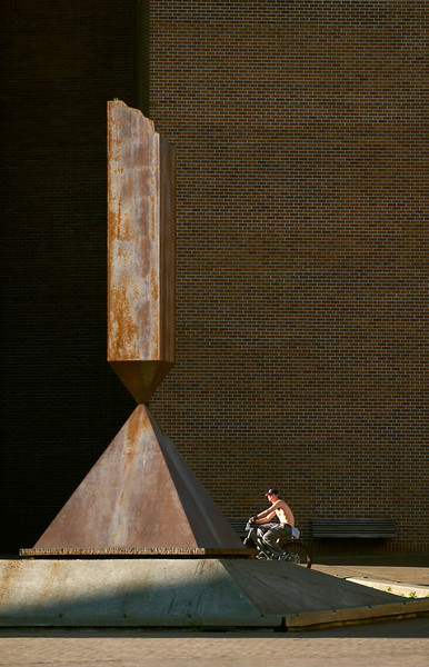A bicyclist checks out the Broken Obelisk in Red Square