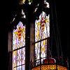 Chandelier and stained glass window in Graduate Reading Room of Suzzallo Library