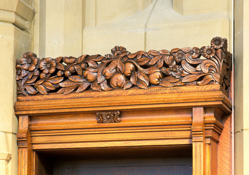 Detail of one of the decorative carvings by H L Erickson located above the doors to the Graduate Reading Room of Suzzallo Library