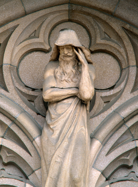 """Thought,"" one of three figures above the portals to Suzzallo Library.  The other two represent ""Inspiration,"" and ""Mastery."""