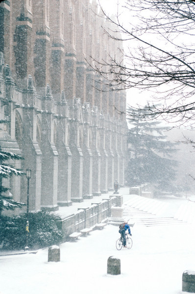 A bicyclist heads into Red Square in front of Suzzallo Library in a January, 1989 snowstorm