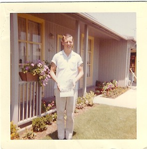 Dad in Livermore with yearbook after high school graduation