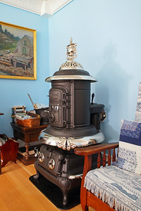 Refurbished coal stove to heat the house.