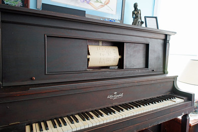 Player piano in living room. Found the receipt from 1929 for $330 dollars = $4,564 today.