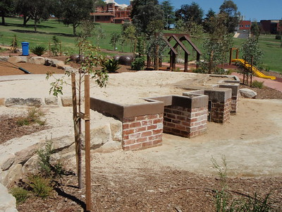 raised sandpit with brick walls and accessible bays
