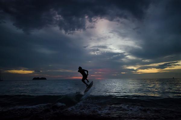 Skimboarding into sunset
