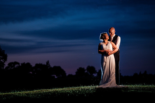 Bride and groom dusk portrait