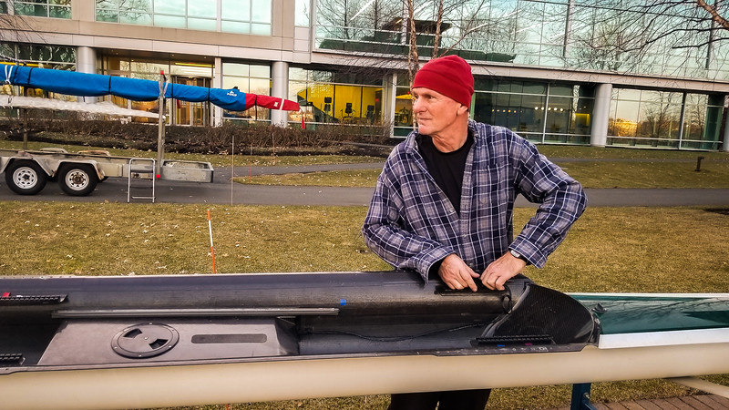 Brian Dawe, the head crew coach at Tufts, helping us load the boats we just bought from him.